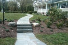 A beautiful front walkway sets off this house.
