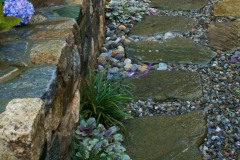 Pebble pathway offers alternative to grass.
